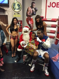 Jesse Hart with Santa and The Sumo Steak Ring Ring Girls presenting toys to children in need.